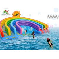 Quality Anti - UV Inflatable Water Parks Triple Lanes PVC Rainbow Slide With Swimming Pool For Rentals for sale